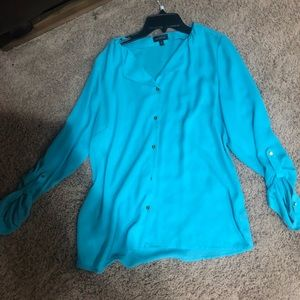 The limited blue button down top